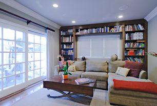 Traditional Living Room with Built-in bookshelf, Crown molding, Hardwood floors
