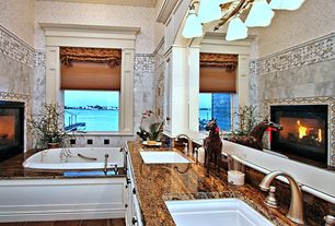Traditional Master Bathroom with Undermount sink, stone tile floors, Bathtub, Flat panel cabinets, High ceiling, Wall Tiles