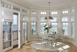 "Traditional Dining Room with Chandra Gloria Glo18605 White Area Rug 7'9"" Round, Pendant light, Transom window, Ocean view"