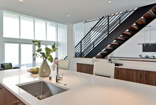 Modern Kitchen with Undermount stainless steel sink, One-wall, Undermount sink, White solid surface counter top, Flush