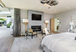 Contemporary Master Bedroom with interior wallpaper, Hardwood floors