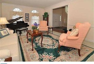 Traditional Living Room with Carpet, Arched window, Crown molding, Chair rail