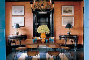 Eclectic Dining Room with Standard height, Chandelier, Crown molding, Hardwood floors, interior wallpaper, Built-in bookshelf