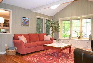 Cottage Living Room with Standard height, Skylight, Exposed beam, Hardwood floors, Bay window, Crown molding, Window seat