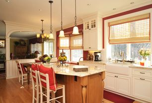 Country Kitchen with Farmhouse sink, Crown molding, Inset cabinets, Subway Tile, Breakfast nook, Breakfast bar, Pendant light