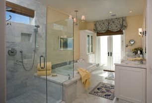 Traditional Master Bathroom with Flat panel cabinets, Rain shower, Complex marble counters, Handheld showerhead, Flush