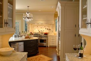 """Traditional Kitchen with Glass panel, Schonbek La Scala Collection 23"""" Wide Crystal Chandelier, Farmhouse sink, Custom hood"""