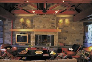 Craftsman Living Room with can lights, Built-in bookshelf, specialty window, picture window, slate floors, Exposed beam