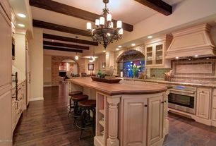 Country Kitchen with Wood counters, Complex granite counters, Raised panel, Kitchen island, Stone Tile, Limestone Tile