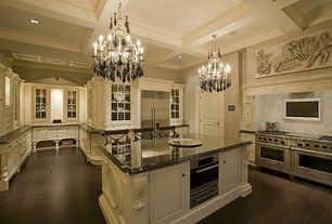 Traditional Kitchen with Kitchen island, Crown molding, Slab backsplash, Glass front cabinets, specialty door, Custom hood