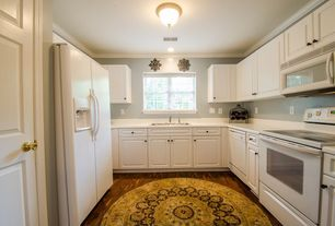 Traditional Kitchen with specialty door, flush light, Hampton bay 2-light oil-rubbed bronze flush mount, Hardwood floors