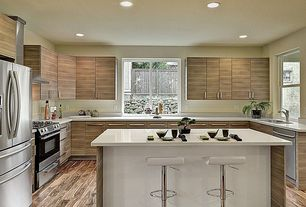 Contemporary Kitchen with Breakfast bar, Corian counters, Flush, European Cabinets, Kitchen island, U-shaped
