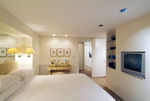 Contemporary Master Bedroom with Built-in bookshelf, Carpet