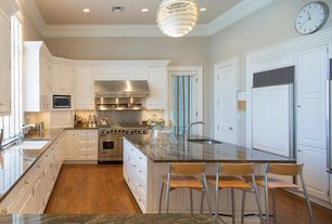 Modern Kitchen with Oak - gunstock 5 in. solid hardwood wide plank, specialty door, Chandelier, Undermount sink, U-shaped