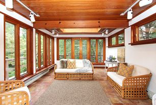 Craftsman Porch with Exposed beam, sandstone tile floors, flush light, Crown molding, Window seat