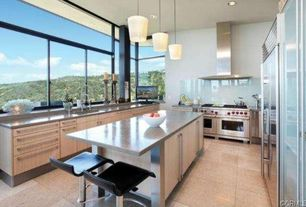 Contemporary Kitchen with U-shaped, Corian counters, Pendant light, Stainless steel hood, Kitchen island, Flush