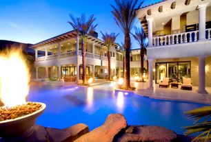 Mediterranean Swimming Pool with Fence, Fire pit, Arched window, exterior stone floors