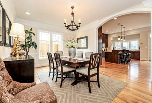 Traditional Dining Room with Crown molding, Chandelier, Chair rail, Hardwood floors