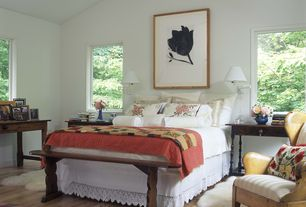 Cottage Guest Bedroom with High ceiling, Hardwood floors