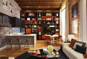 Eclectic Great Room with High ceiling, Built-in bookshelf, Laminate floors, Walton sofa, Smeg refrigerator - orange