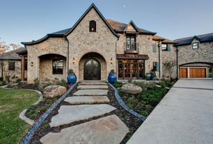 Traditional Exterior of Home with Abby Iron Doors, Barn door, Arched window, Pathway, Rock Black River, French doors