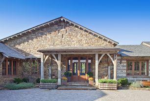 Country Front Door with exterior brick floors, Glass panel door, Raised beds