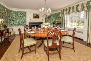 Traditional Dining Room with Fireplace, Standard height, double-hung window, Crown molding, Hardwood floors, insert fireplace