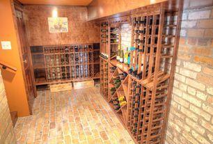 Rustic Wine Cellar with interior brick, Brick floors, High ceiling, Built-in bookshelf, specialty door, Exposed beam