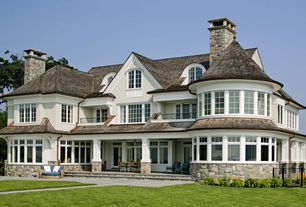 Traditional Exterior of Home with Pathway, Transom window, French doors, Arched window, Fence