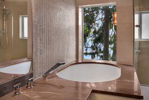 Contemporary Master Bathroom with Soapstone counters, Handheld showerhead, frameless showerdoor, Soapstone, Bathtub, Casement