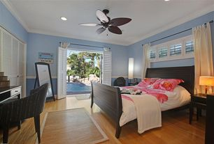 Traditional Guest Bedroom with Chair rail, Hardwood floors, Ceiling fan, French doors, Built-in bookshelf, Forsyth bed