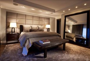 Contemporary Master Bedroom with Crown molding, Kathy ireland home oculus wrought iron table lamp, Hardwood floors