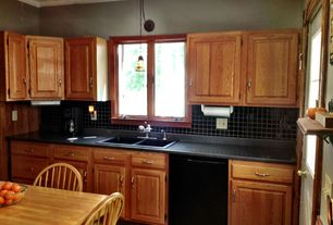 Traditional Kitchen with Casement, Inset cabinets, stone tile floors, Pendant light, Crown molding, Glass panel door