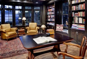 Traditional Library with Built-in bookshelf, Box ceiling, double-hung window, Crown molding, Hardwood floors, Window seat