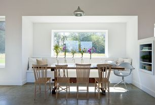 Contemporary Dining Room with Pendant light, Built-in bookshelf, Window seat, Concrete floors
