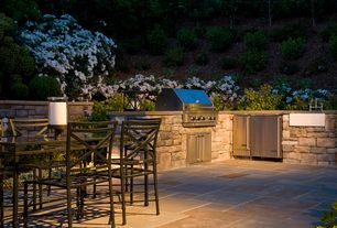 Traditional Patio with exterior stone floors, Outdoor kitchen