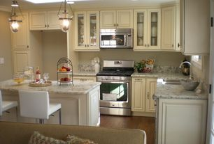 Country Kitchen with Stainless undermount 2-basin sink, L-shaped, gas range, Pottery barn hundi lantern, Breakfast bar, Flush