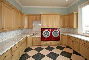 Traditional Laundry Room with stone tile floors, Standard height, Built-in bookshelf, Crown molding, Casement, can lights