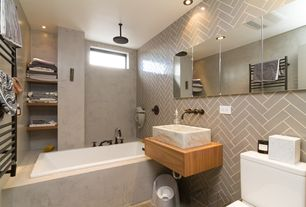 Contemporary Full Bathroom with shower bath combo, Towel warmer, Vessel sink, Bathtub, linen and towel storage cabinet