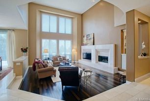 Contemporary Living Room with Sunken living room, High ceiling, Cement fireplace, Hardwood floors