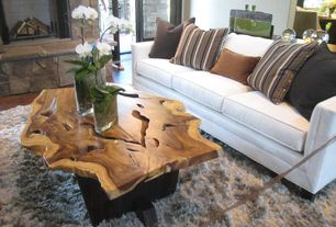 Rustic Living Room with Rustic slab wood coffee table with live edge, Fireplace, Paint, Area rug, Upholstered sofa