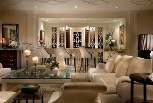 Art Deco Living Room with Hardwood floors, Castle corner chair, Crown molding