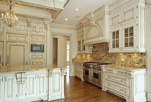 Traditional Kitchen with Kitchen island, Complex Granite, Raised panel, Custom hood, L-shaped, Crown molding, Chandelier