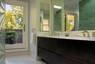 Contemporary Master Bathroom with Complex marble counters, Casement, Flush, Complex Marble, European Cabinets, Double sink