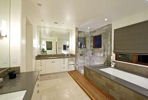 Contemporary Master Bathroom with Flush, Handheld showerhead, Daltile Travertine Collection Noce, Undermount sink