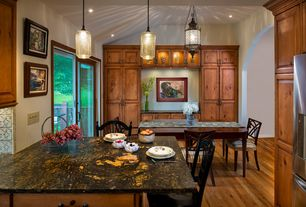 Craftsman Dining Room with Pendant light, Built-in bookshelf, High ceiling, Hardwood floors