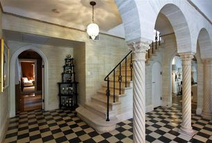 Mediterranean Staircase with interior wallpaper, Pendant light, sandstone floors, Crown molding