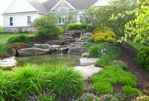 Landscape/Yard with Pond, exterior stone floors, Raised beds, Arched window, Fountain, Pathway