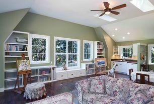 Traditional Great Room with Skylight, Hardwood floors, Ceiling fan, Window seat, Built-in bookshelf