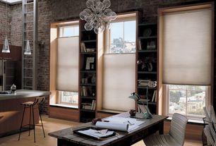 Contemporary Home Office with Pendant light, Chandelier, Built-in bookshelf, Laminate floors